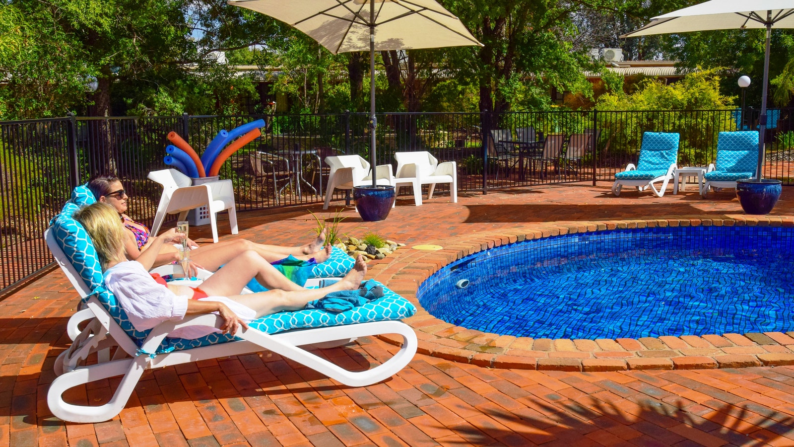 River Country Inn - Relaxing by the Pool