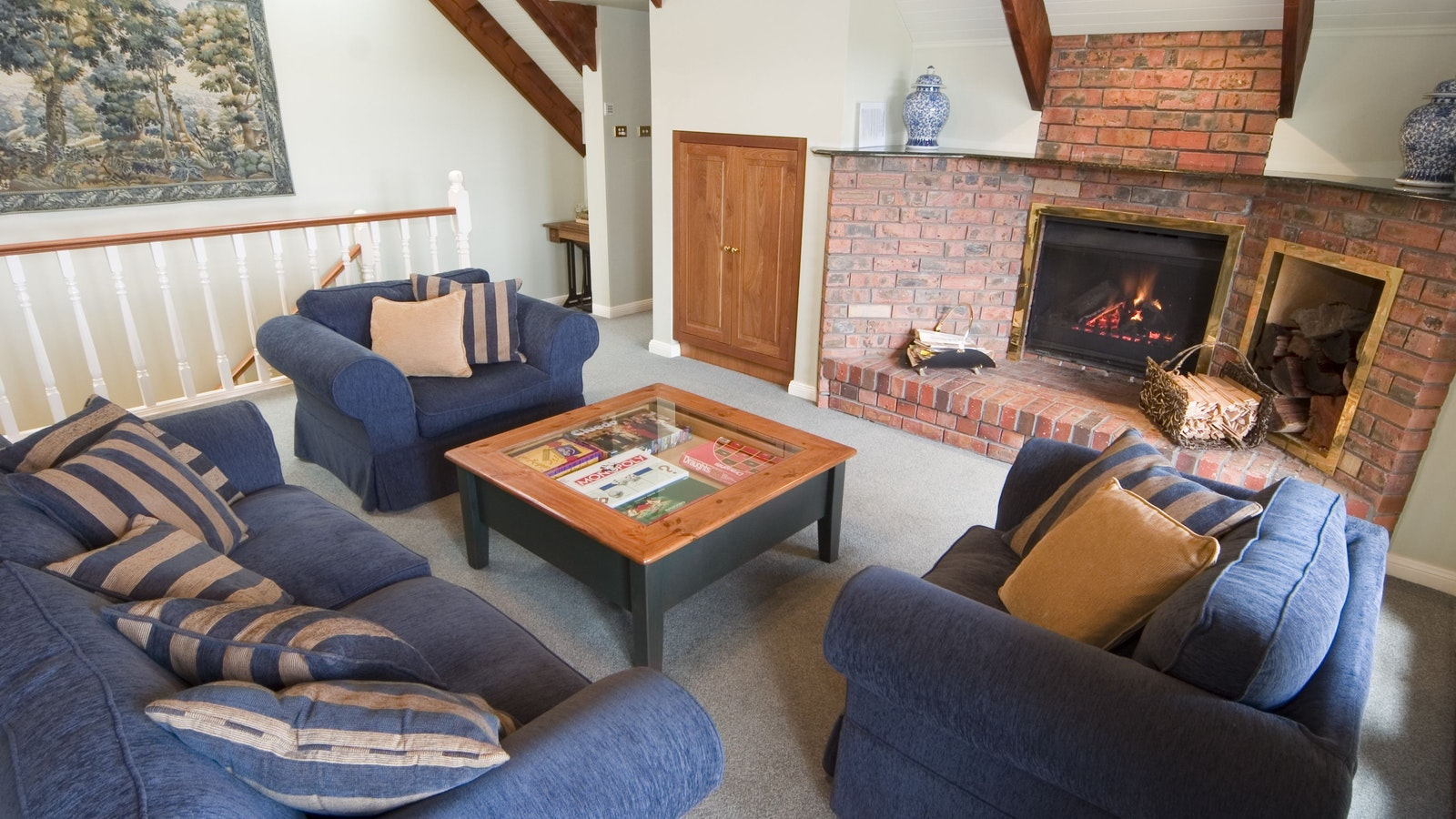 The upstairs lounge and fireplace