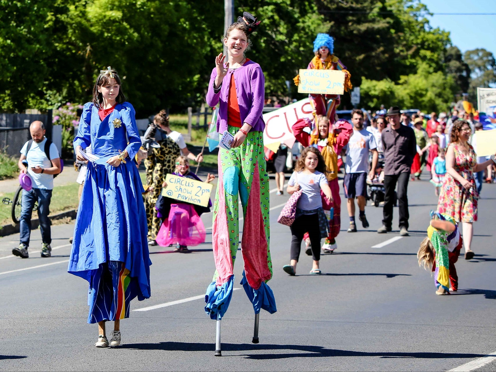 Students on stilts lead the parade to the Hepburn Springs Swiss Italian Festa Family Festa Day