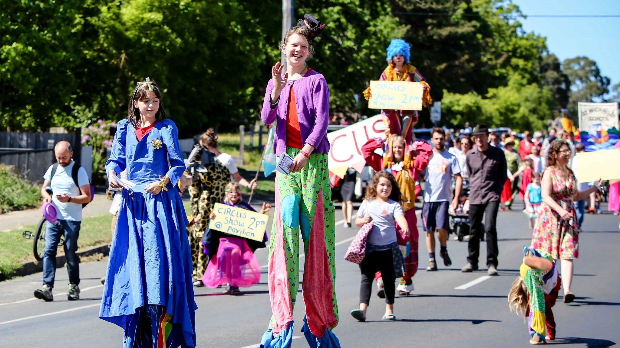 Students on stilts lead the parade to the Hepburn Springs Swiss Italian Festa Family Festa Day