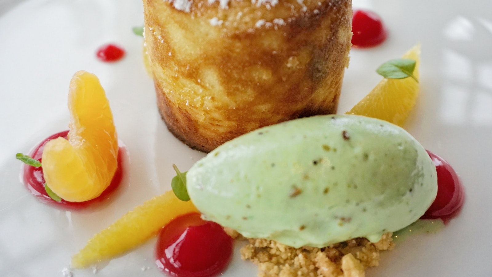White chocolate fondant with mint salad and pistachio ice cream