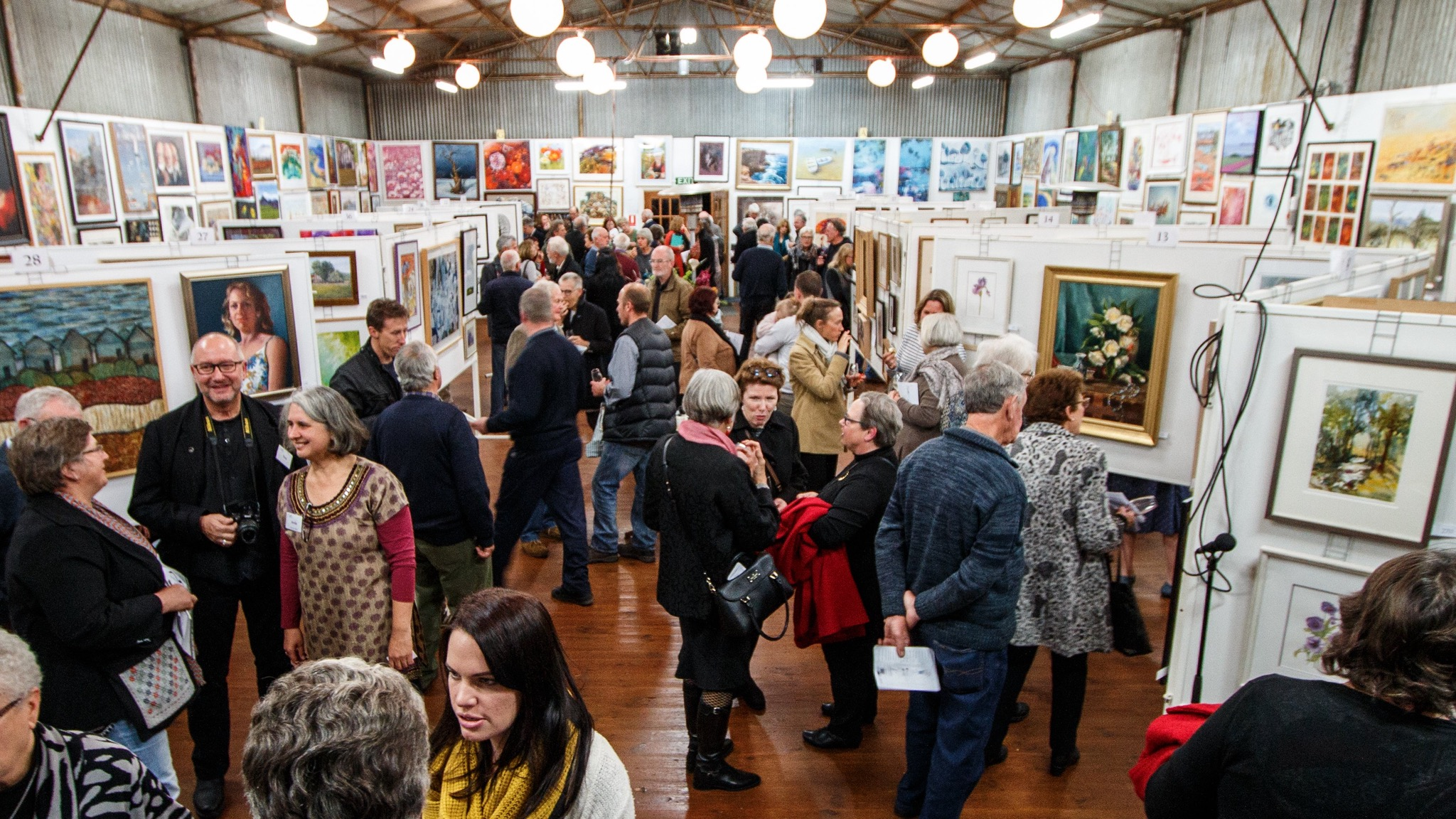 local crowd enjoying King Valley Art Show opening night