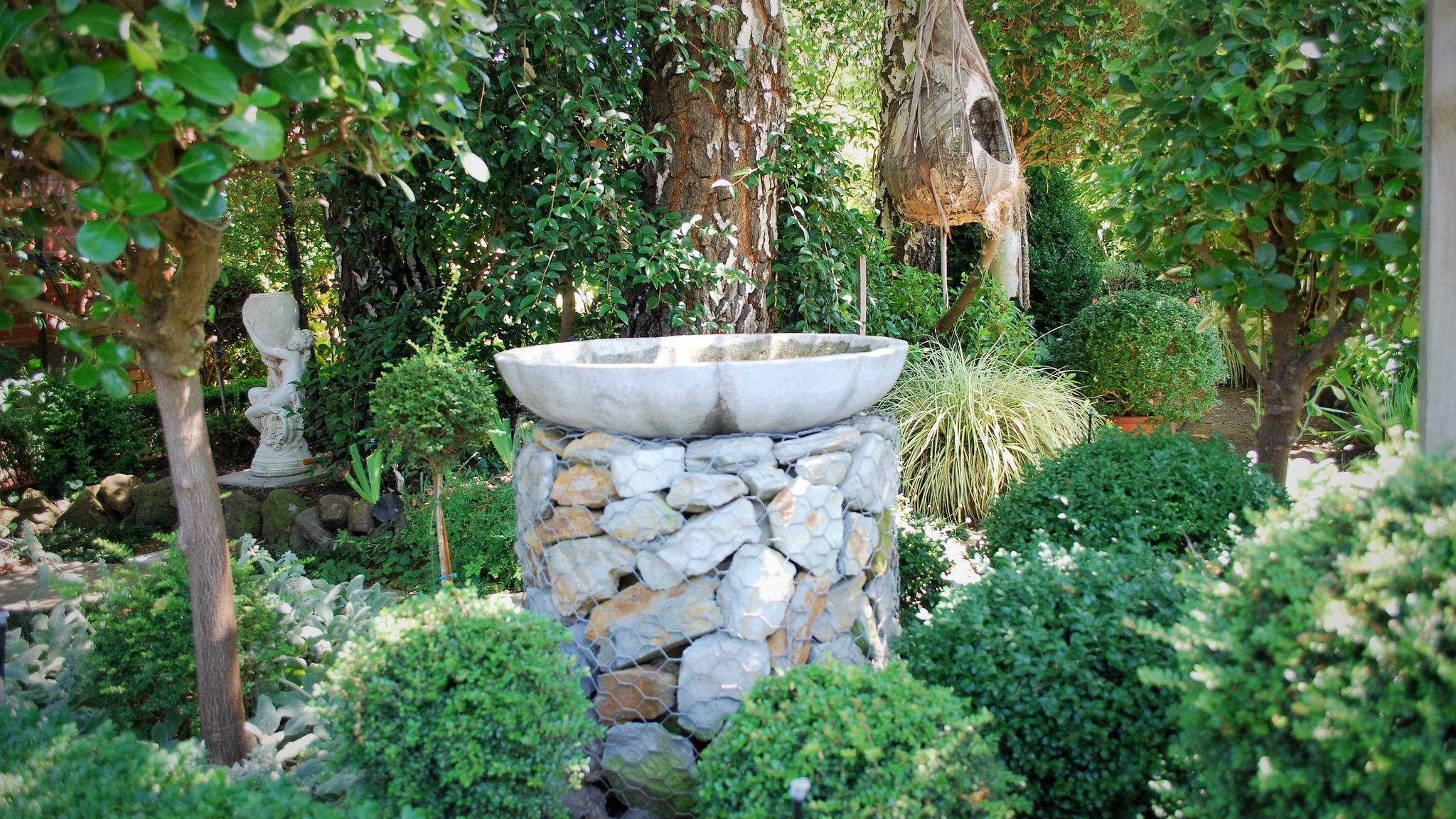 "alt=""bird bath on a stone stand"""