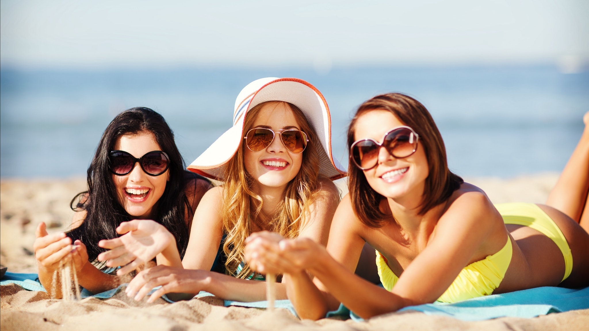 Three happy girls on the beach