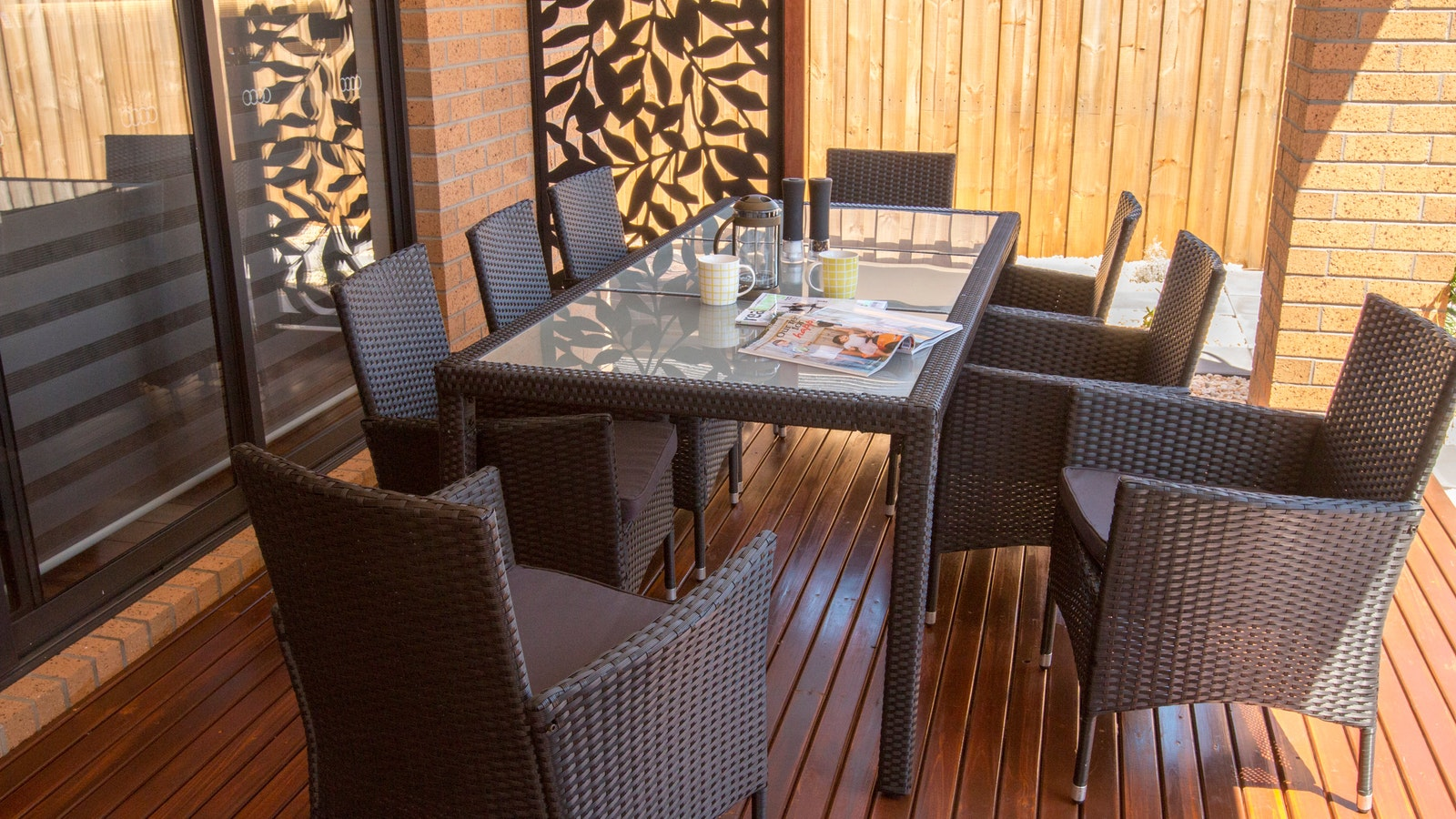 BBQ area with wicker Setting and lounge chairs