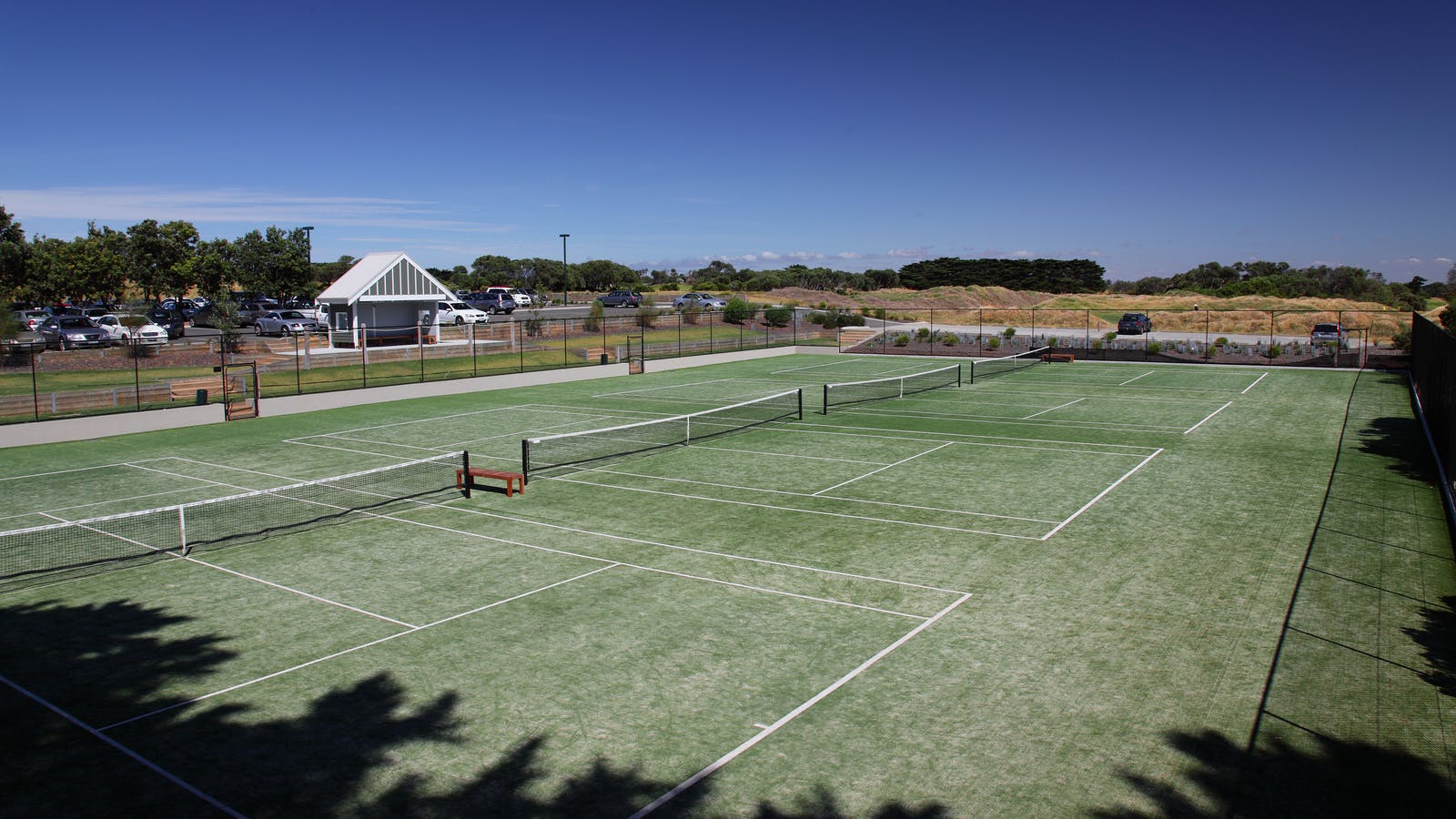 Four Mod-Grass Tennis Courts