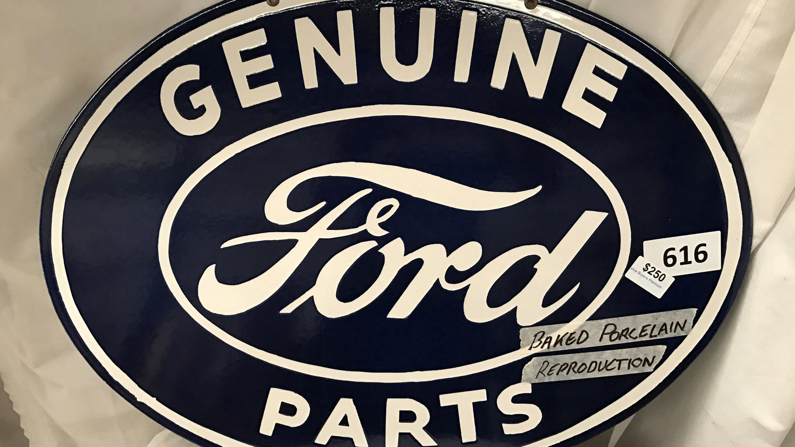Reproduction baked porcelain on metal Ford sign
