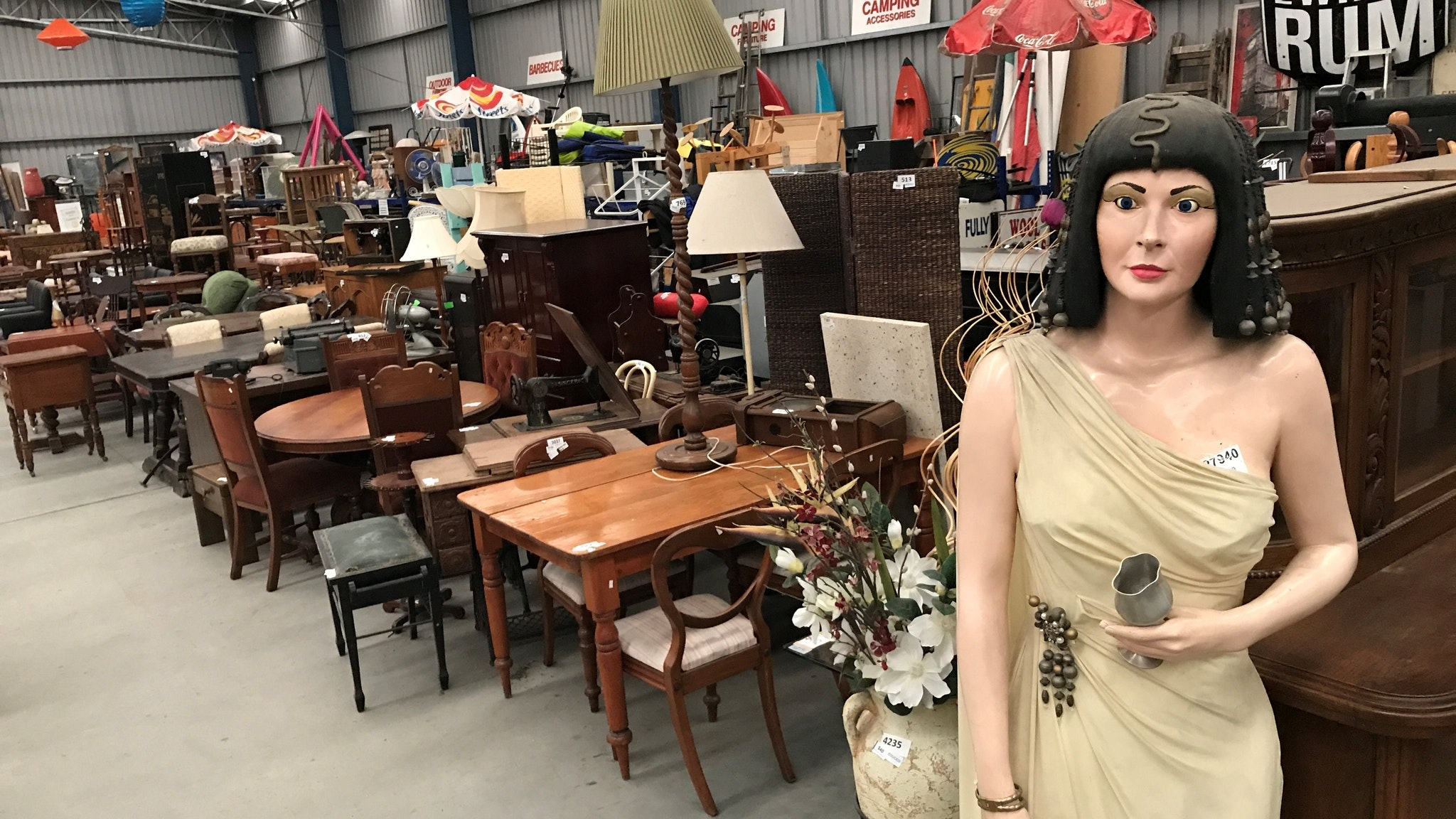 warehouse packed with preloved treasures including furniture, antiques, sports gear & homewares