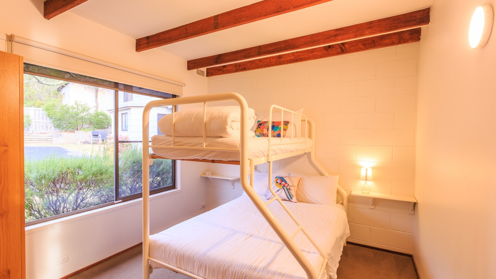 Second bedroom has a tri-bunk with double bed below and single above, perfect for families or groups