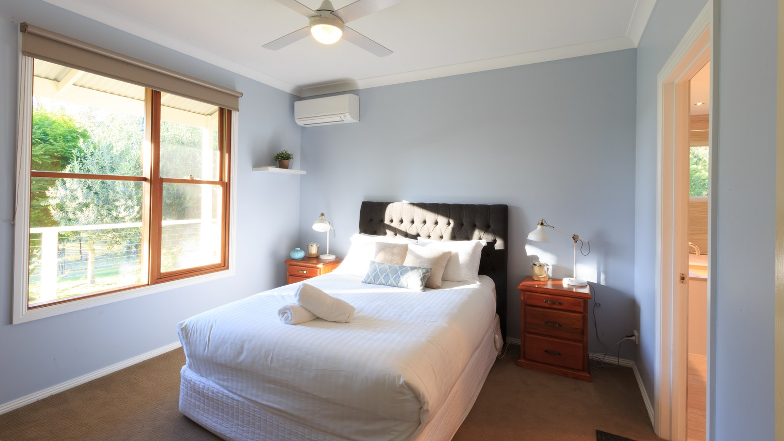 Master bedroom features a queen size bed with king coil mattress and spacious en suite bathroom