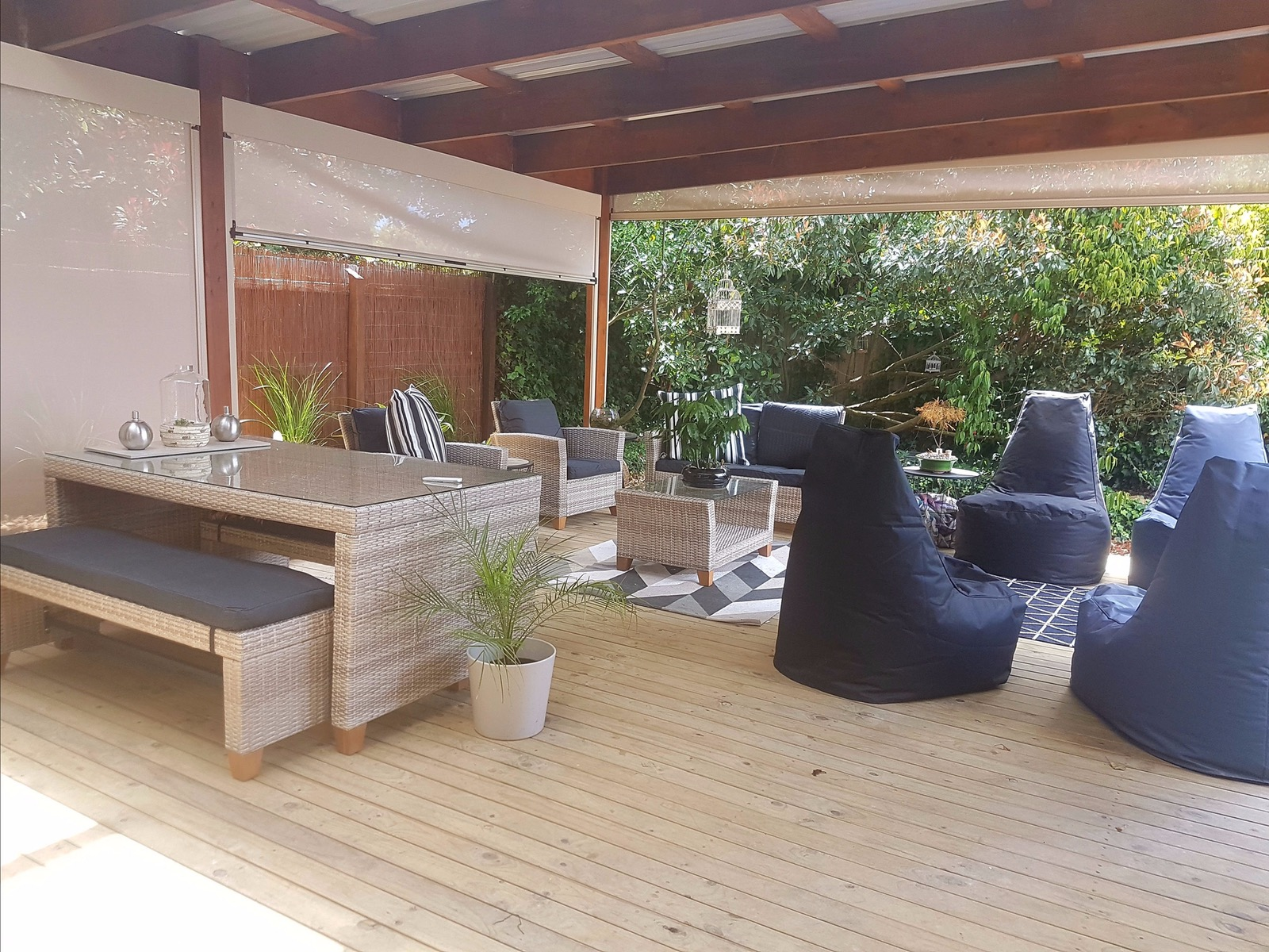 Indoor/outdoor entertainment area with remote control/manual blinds