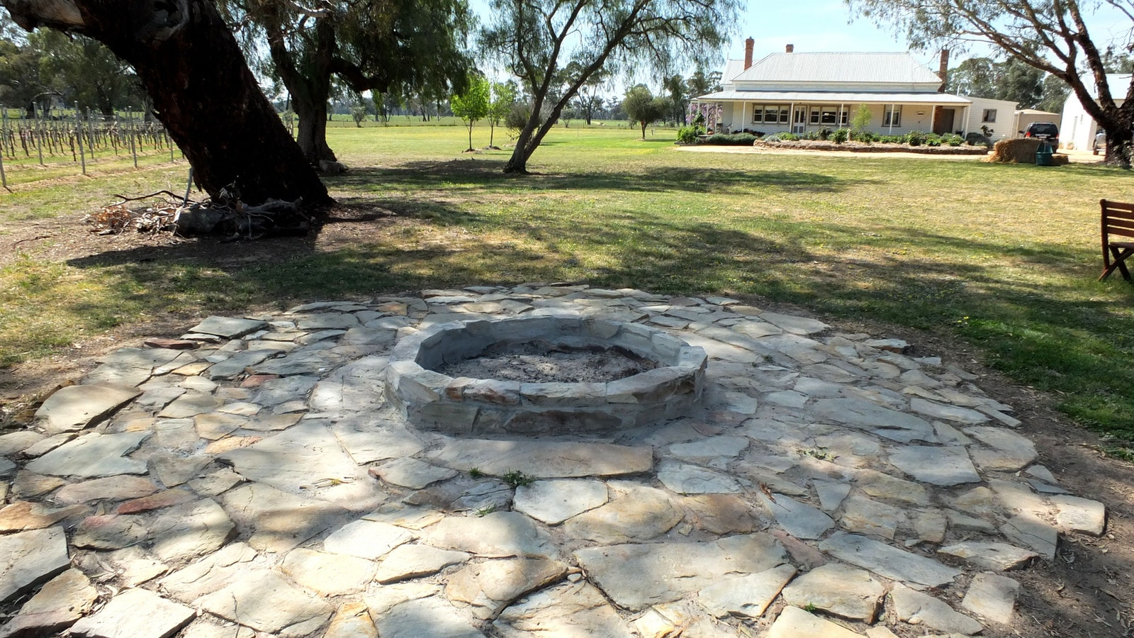 Fire pit at rear of cottage - main house in view