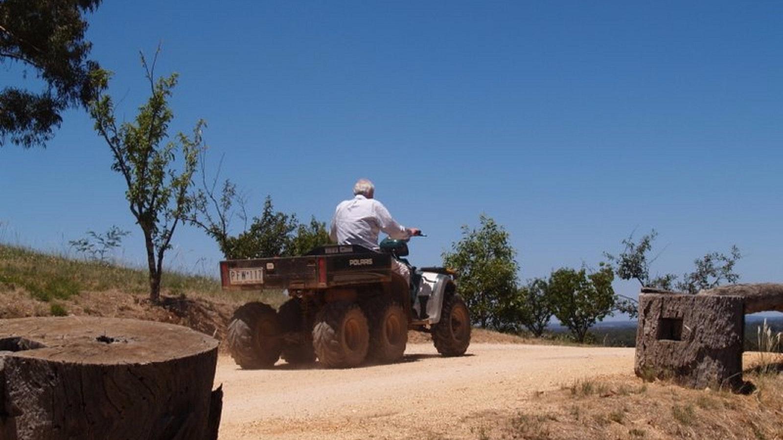 Winemaker on quadbike off to work
