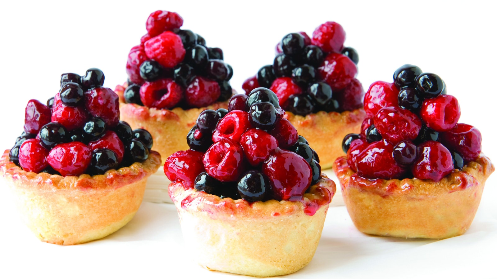 Baked custard in delicious shortcrust pastry topped with juicy berries