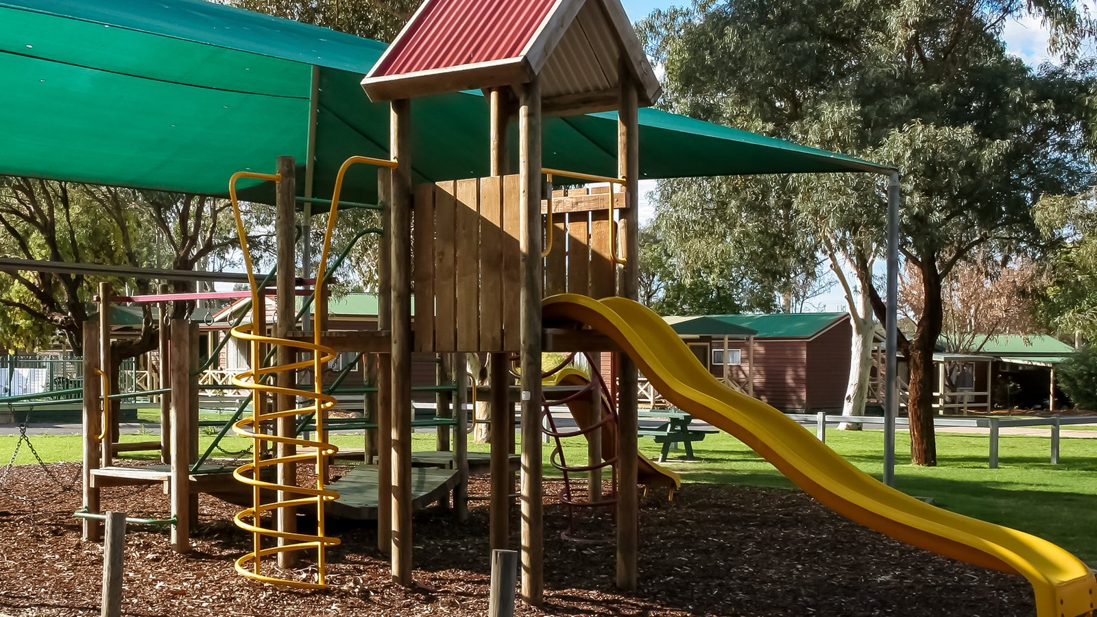 Adventure playground with ladders and slides.