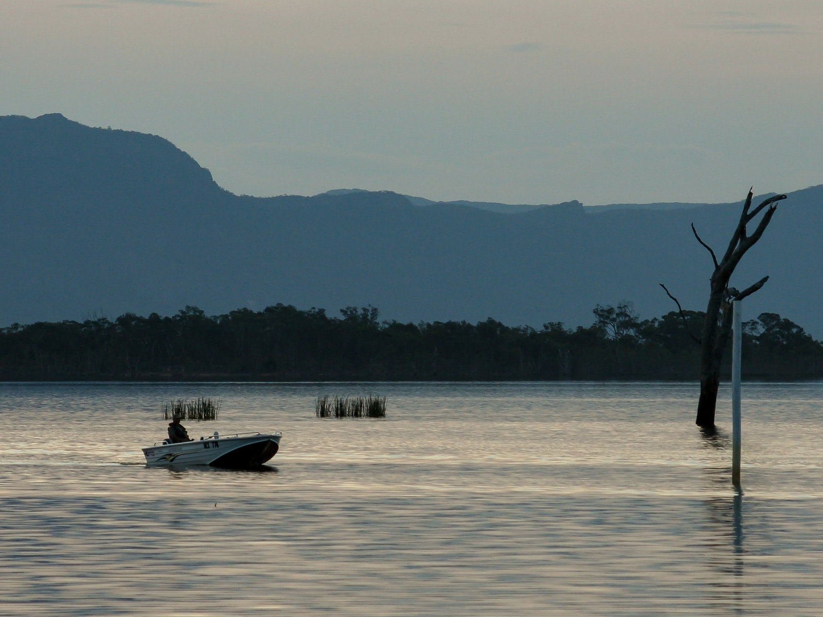 Fishing boat on Lake Fyans with Grampians skyline