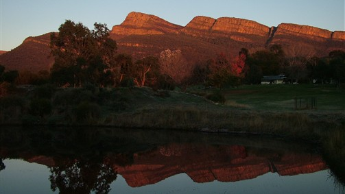 Sunrise at Grampians Paradise Camping and Caravan Plarkland reflected in Observitory Lake