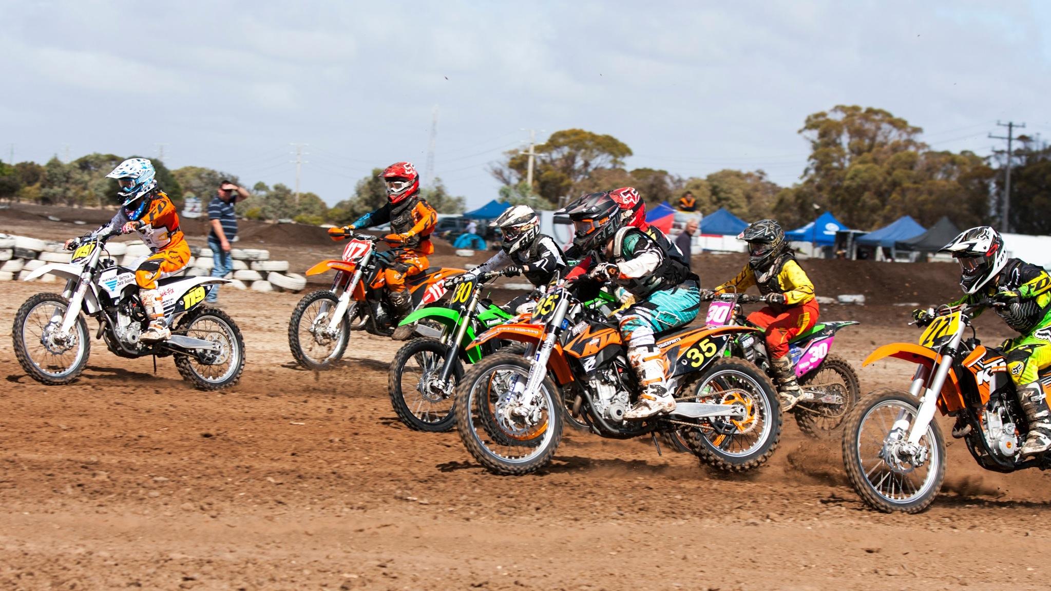 Kids on motor bikes on dirt track