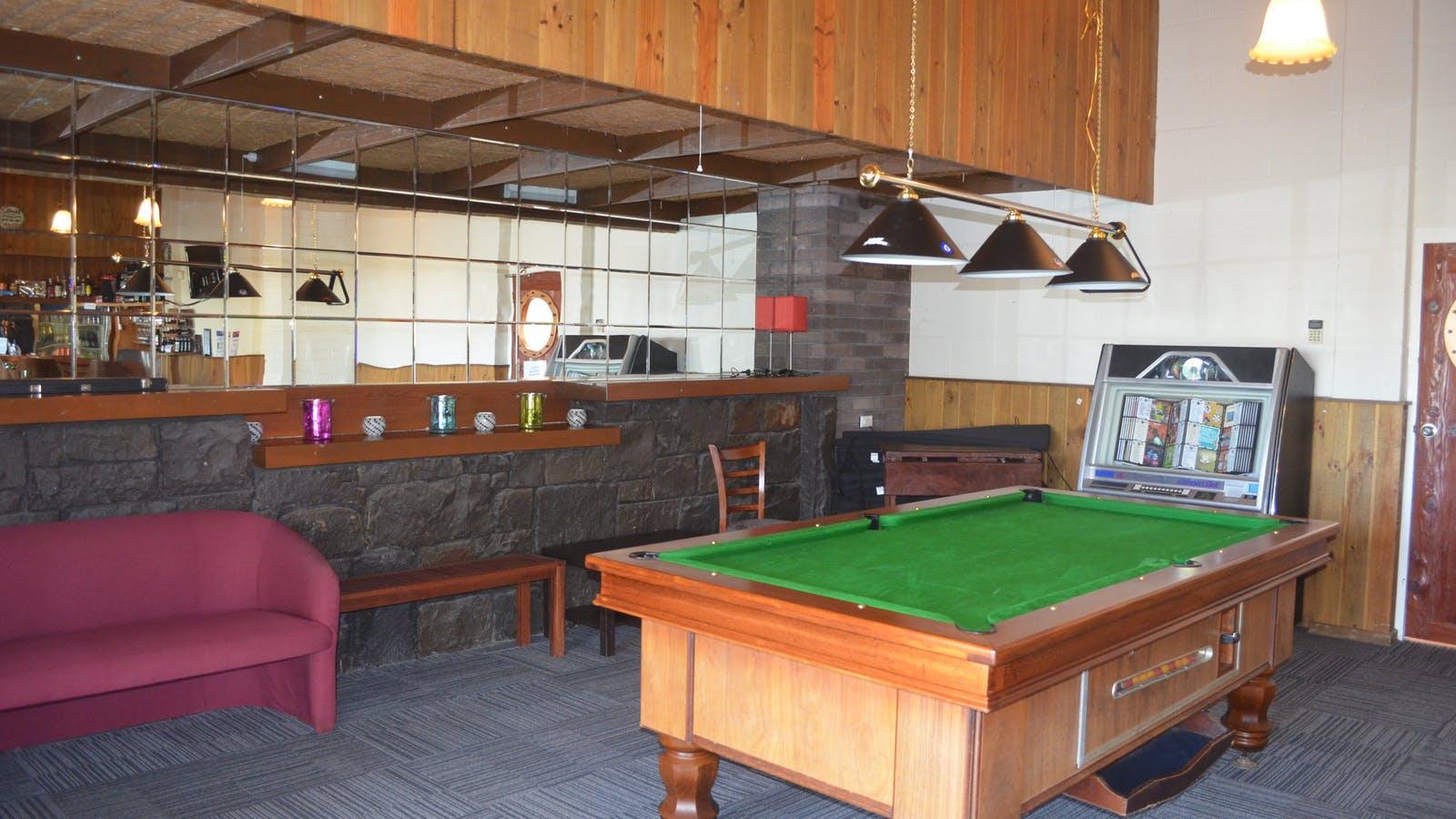 Billiard table and bar