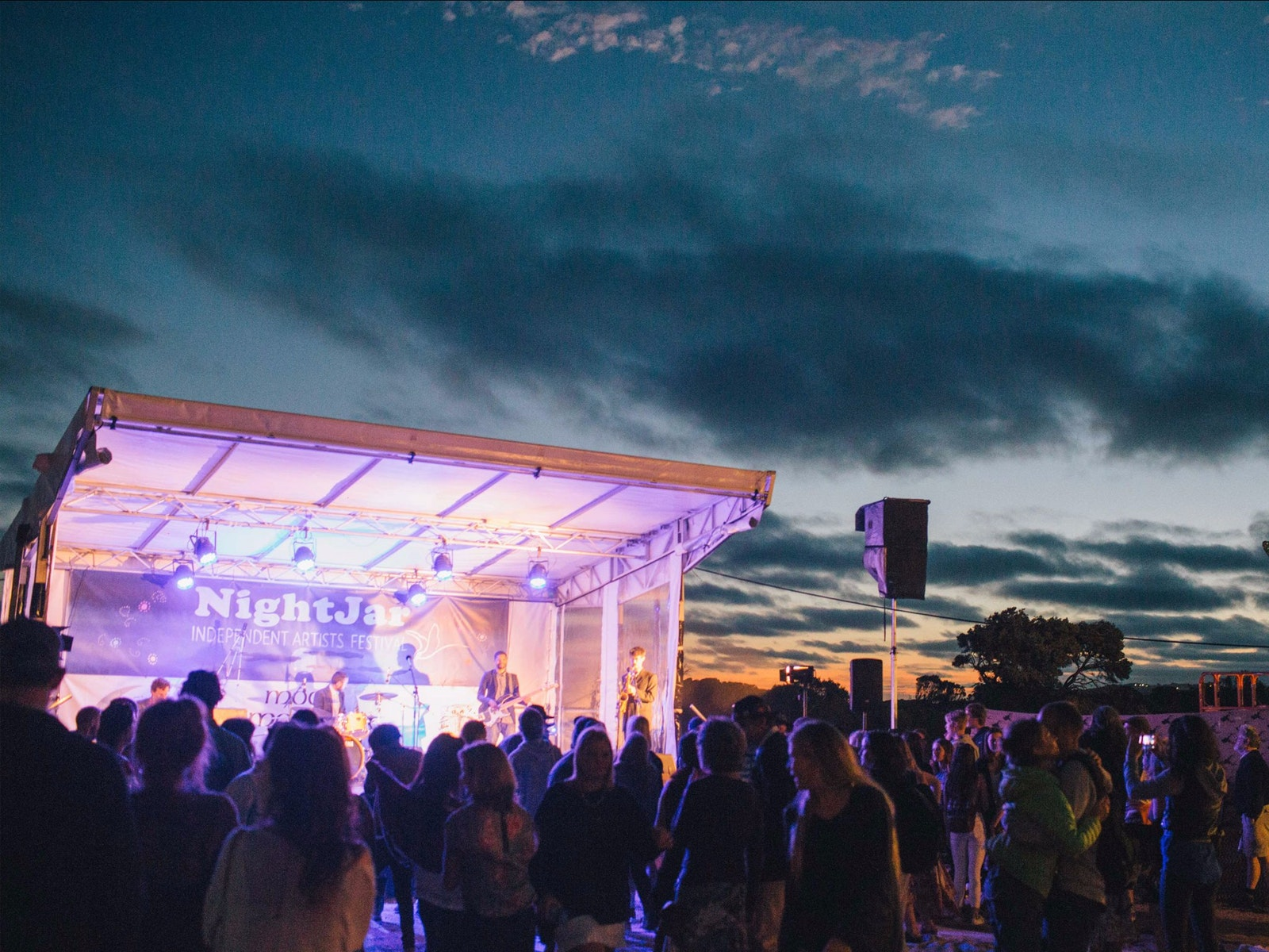 The sun sets behind the Nightjar Festival stage
