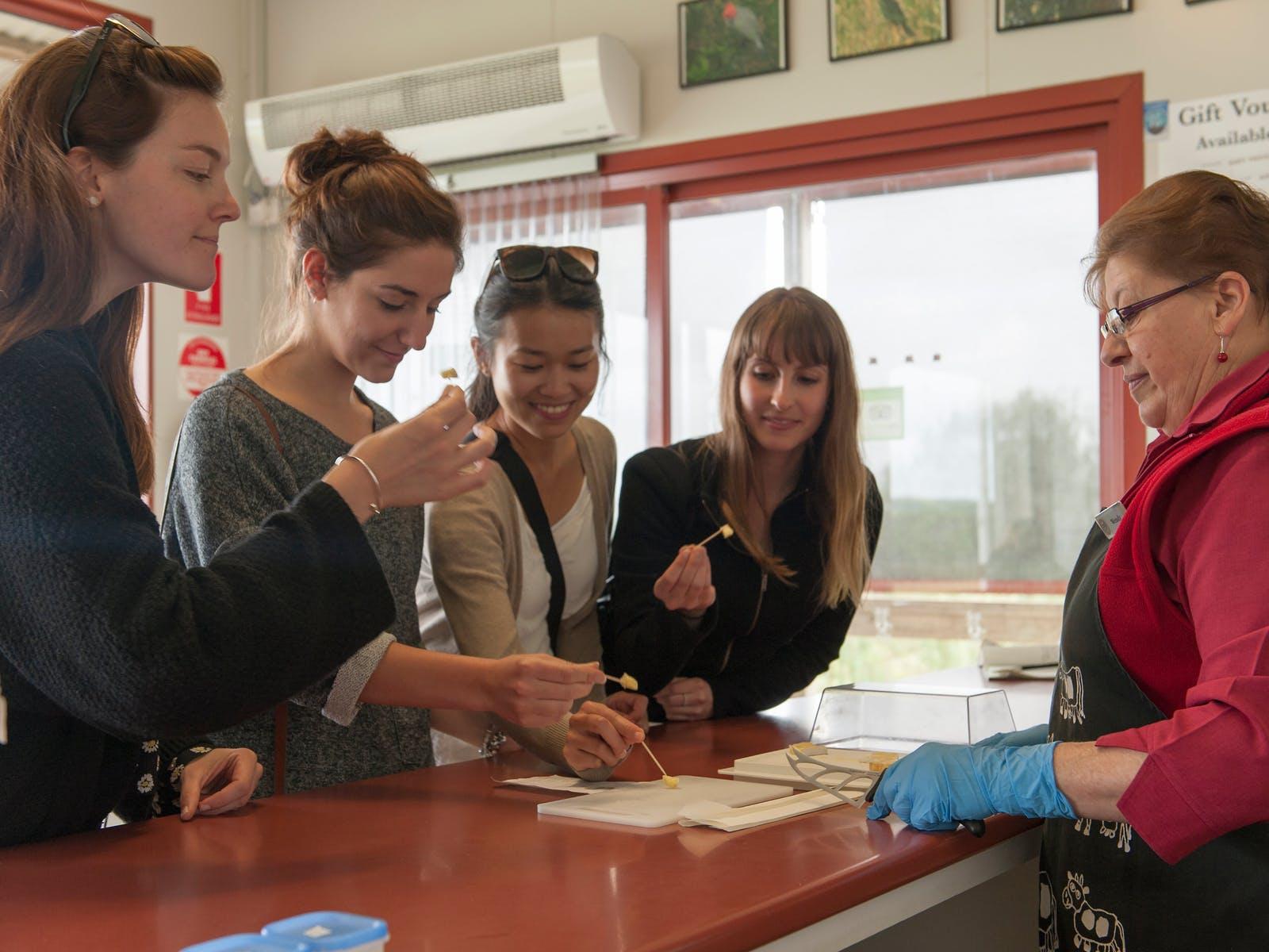 Visitors enjoying samples at Apostle Whey Cheese