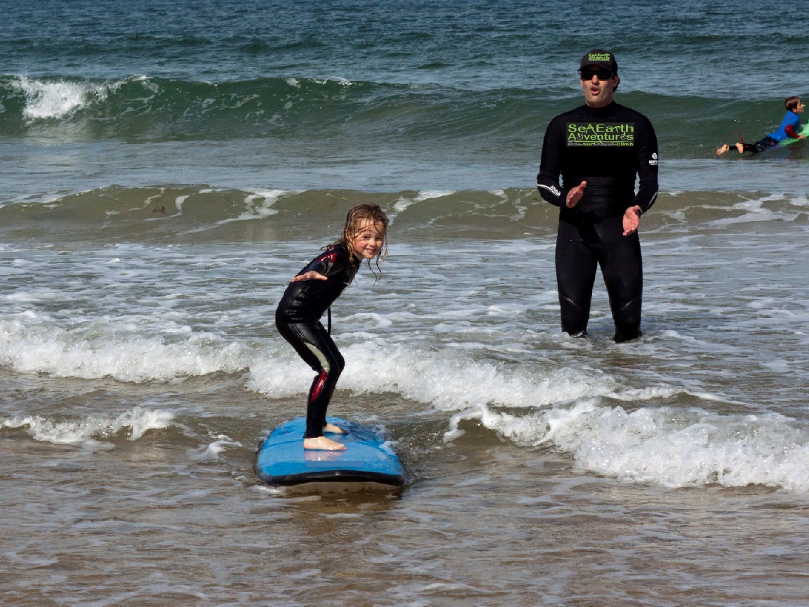 Girl surfing at Torquay