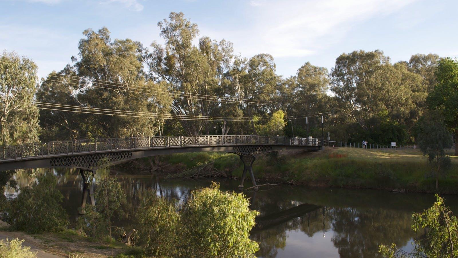 2 minute walk over footbridge to town