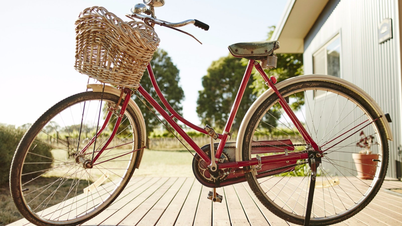 Red bike which is used to ride around the property and area