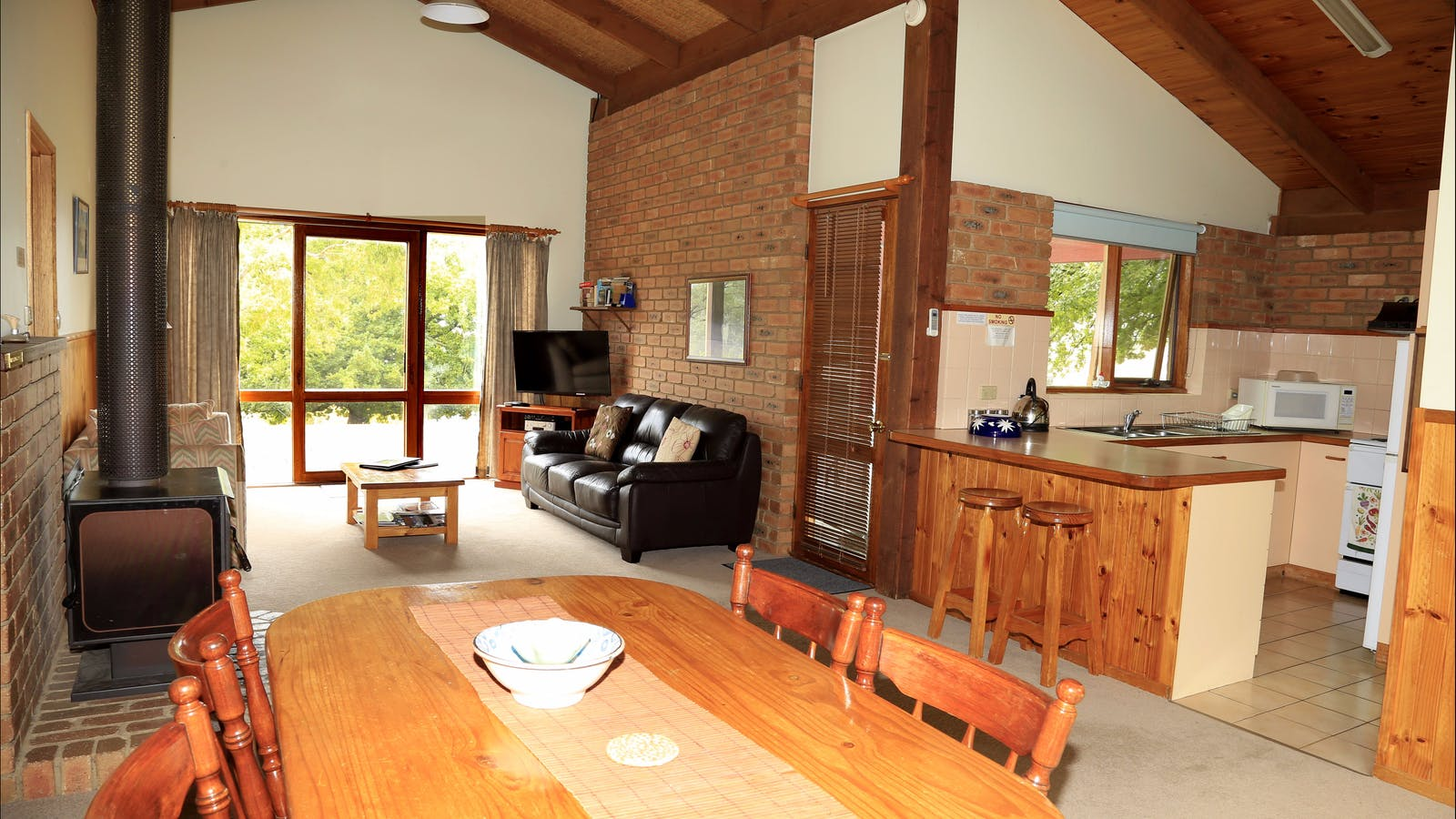 All four cottages have the same layout with spacious lounge-dining with flat screen television