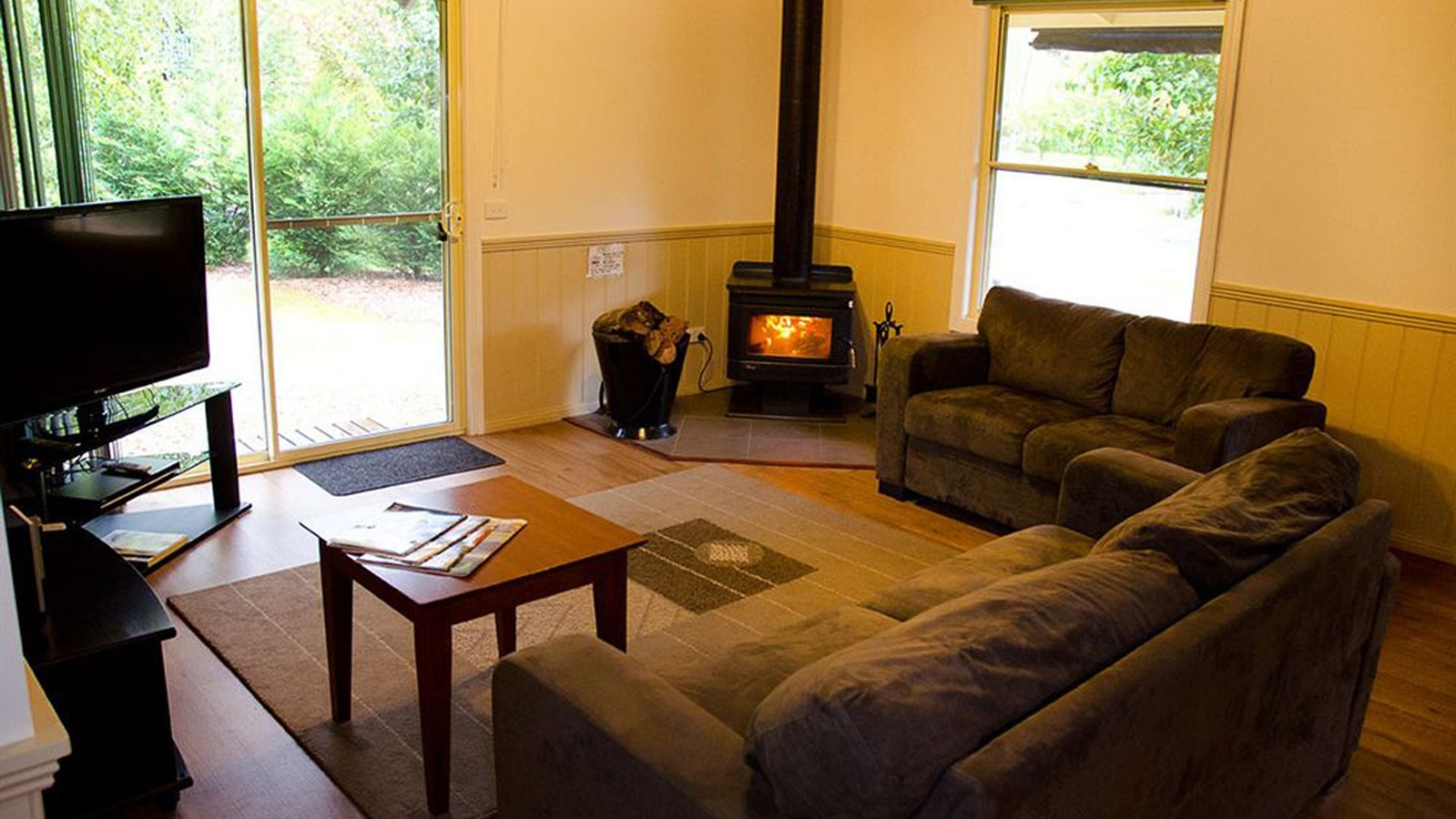 Wood fire and lounge of Spa Cottage Two