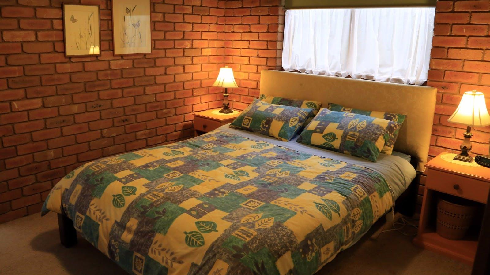 Spacious queen bed in the master bedroom