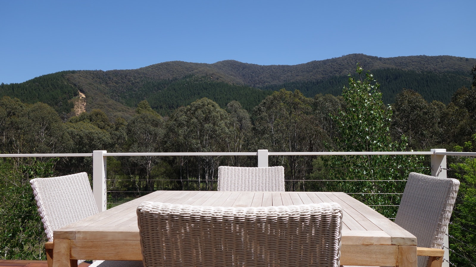 White Wicker Outdoor Dining Table with Panoramic Mountain views