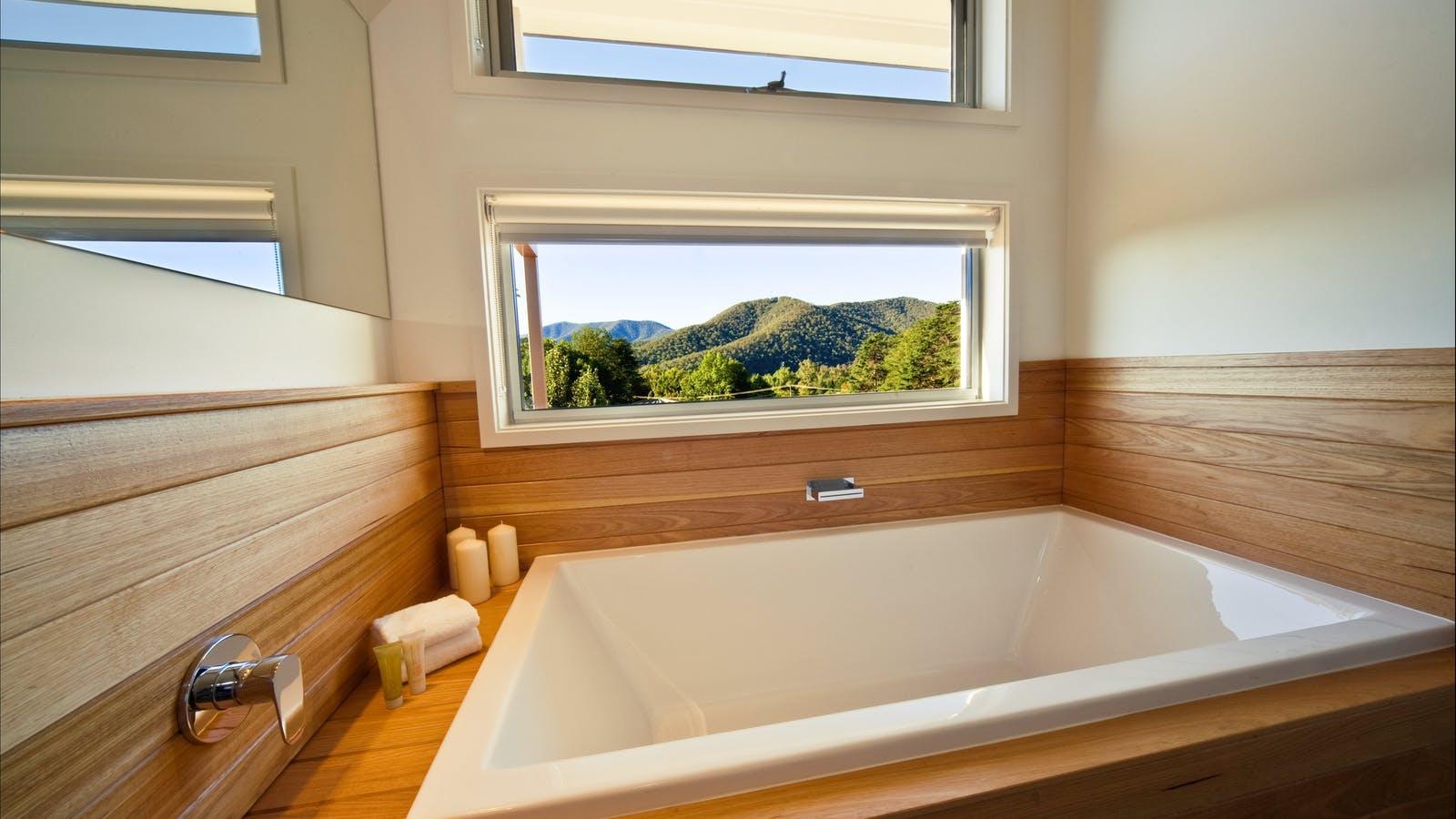 Bath with mountain views