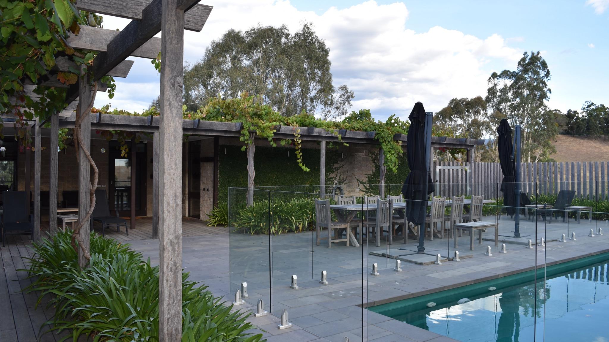 Umbrellas and shady pergolas with grapevines