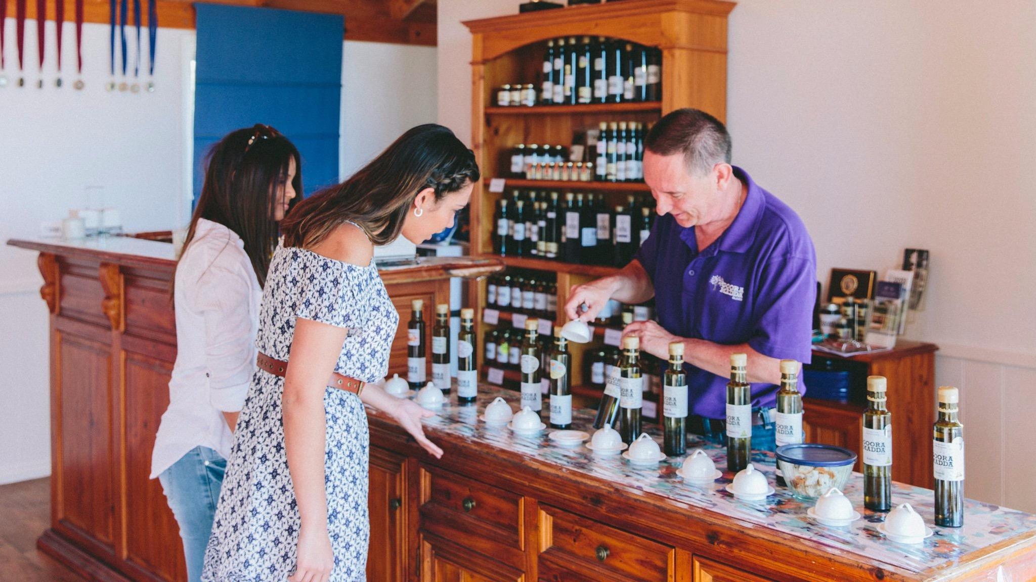 Rob serving customers at Gooramadda Olives