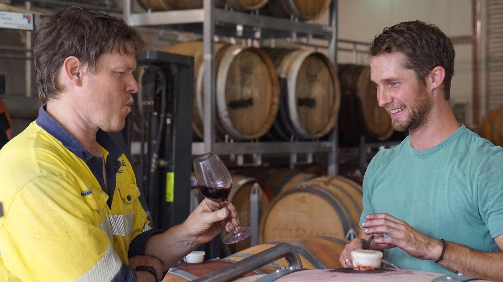 Winemakers taste testing shiraz