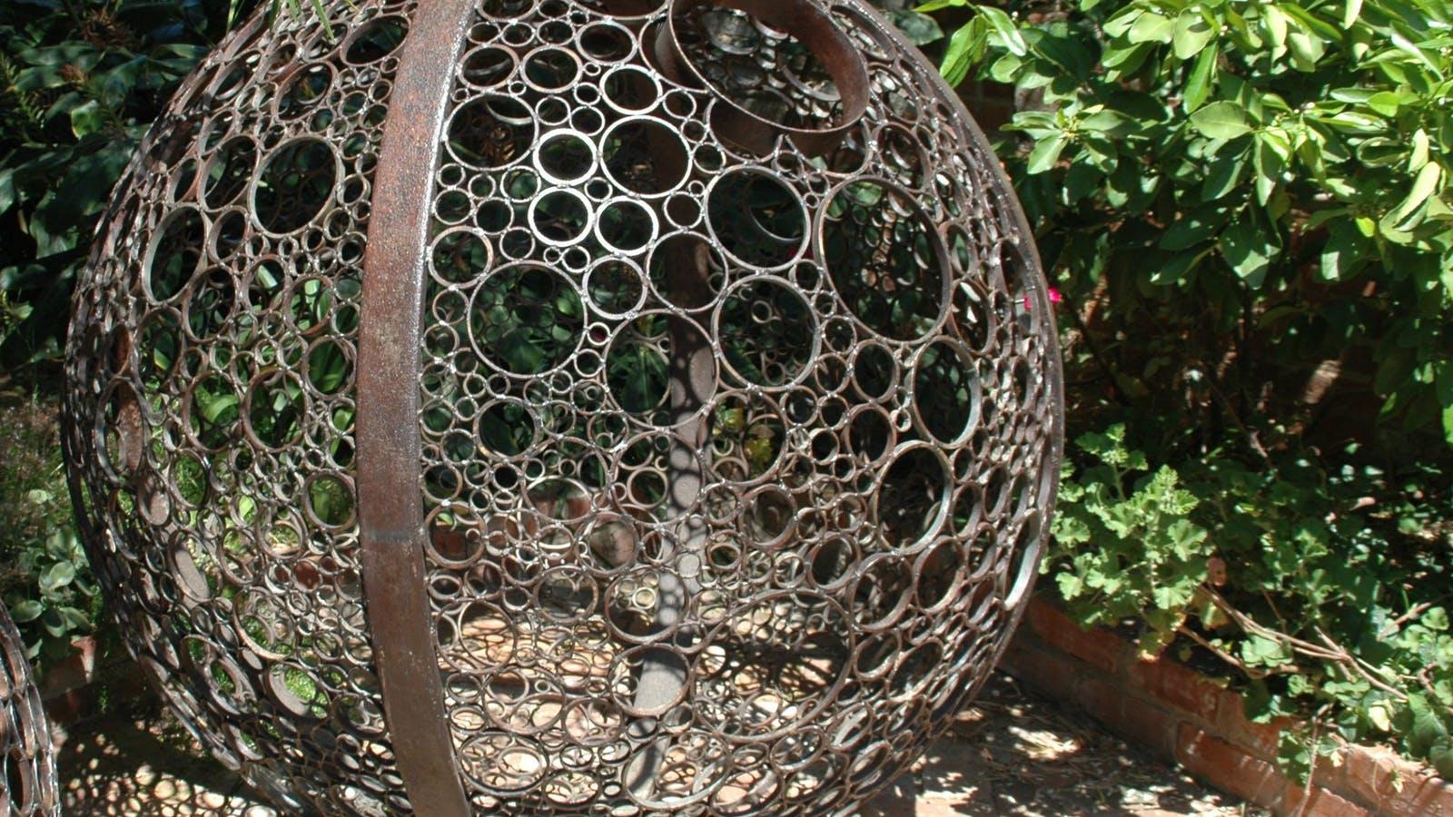Metal ball sculpture at IGA in Rutherglen