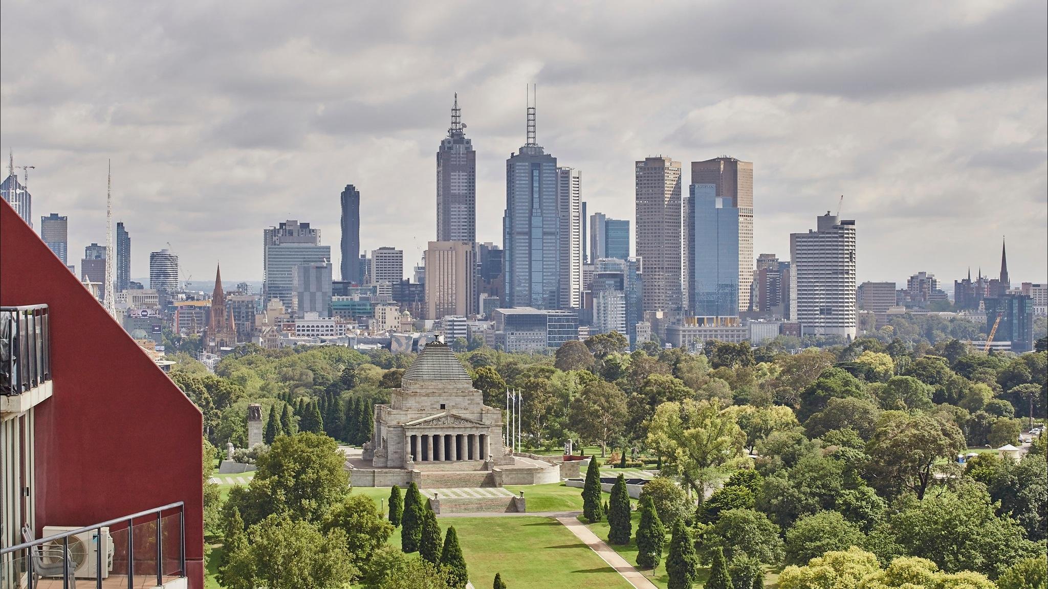 Views depict The Shrine of Remembrance, parklands , city buildings of Melbourne