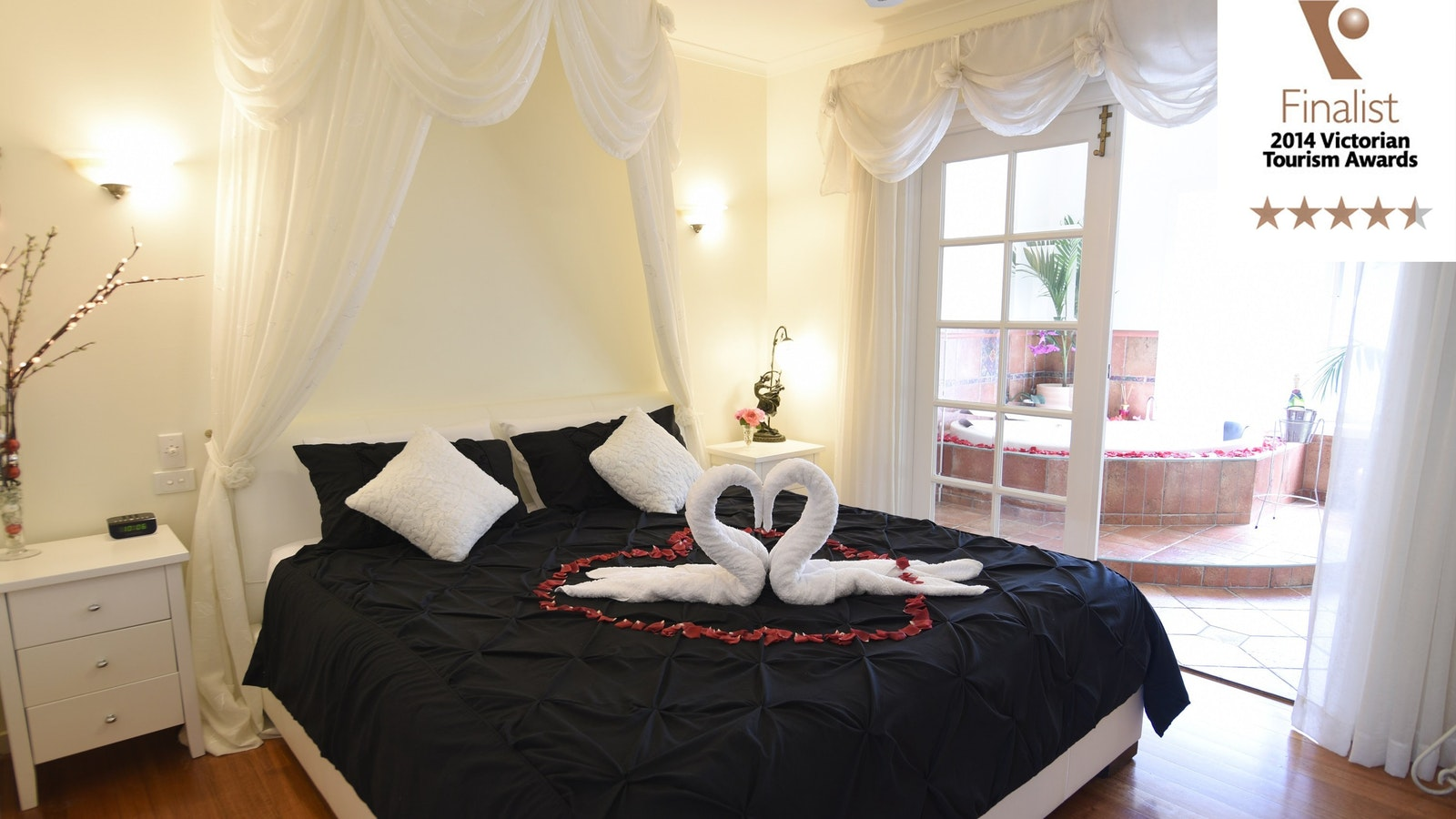 Bedroom and large oval spa