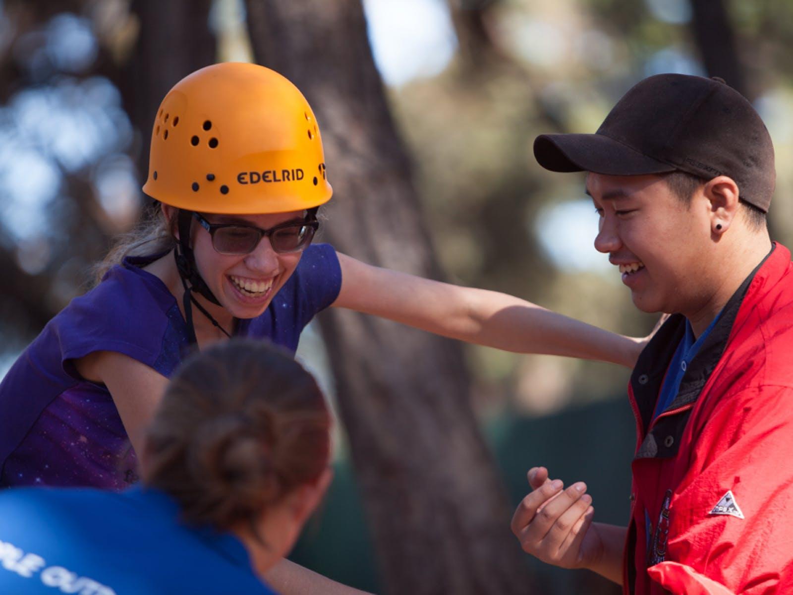 image: girl enjoying low ropes course
