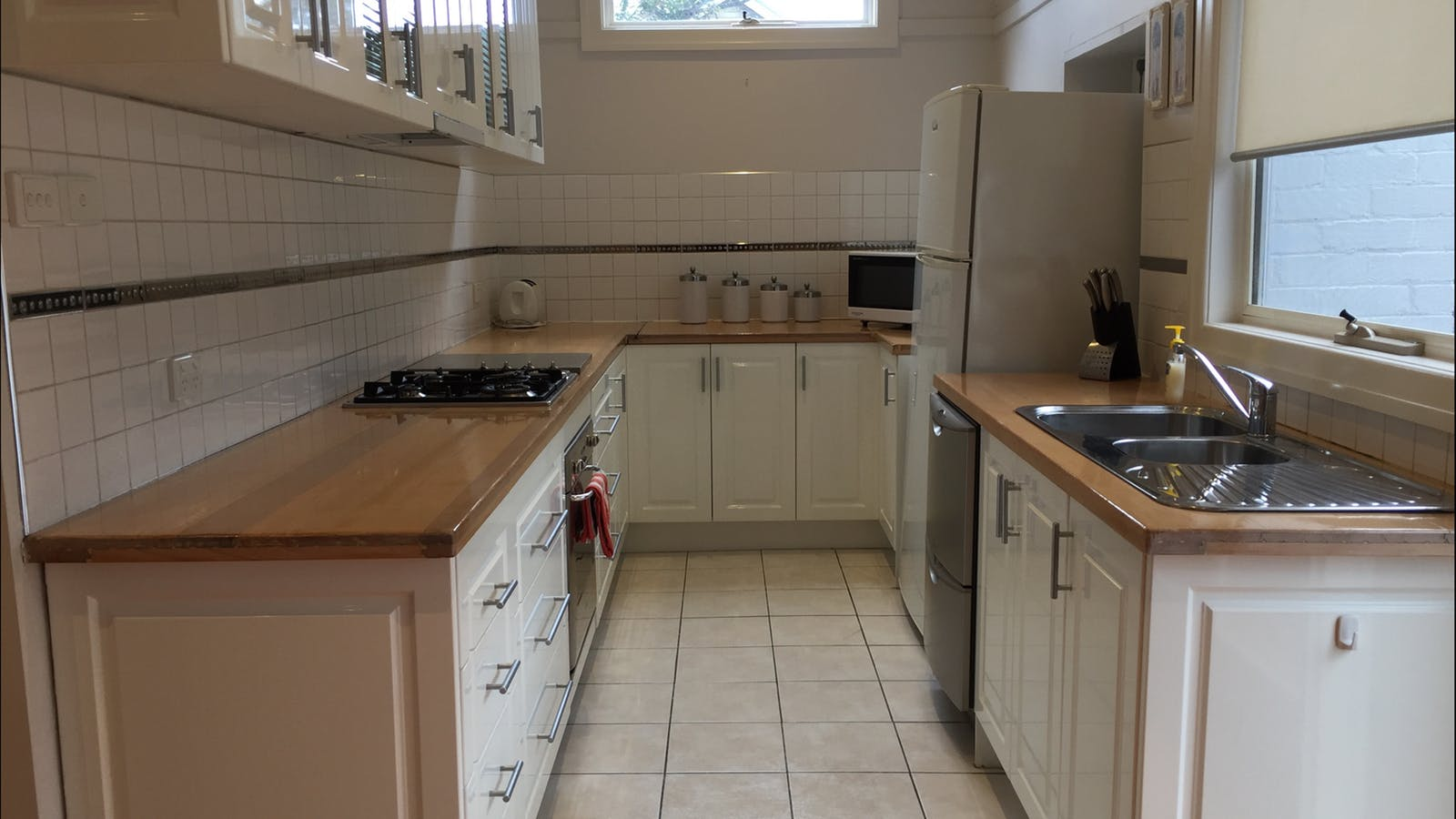 Full kitchen with microwave, dishwasher, oven, stove and all the essentials