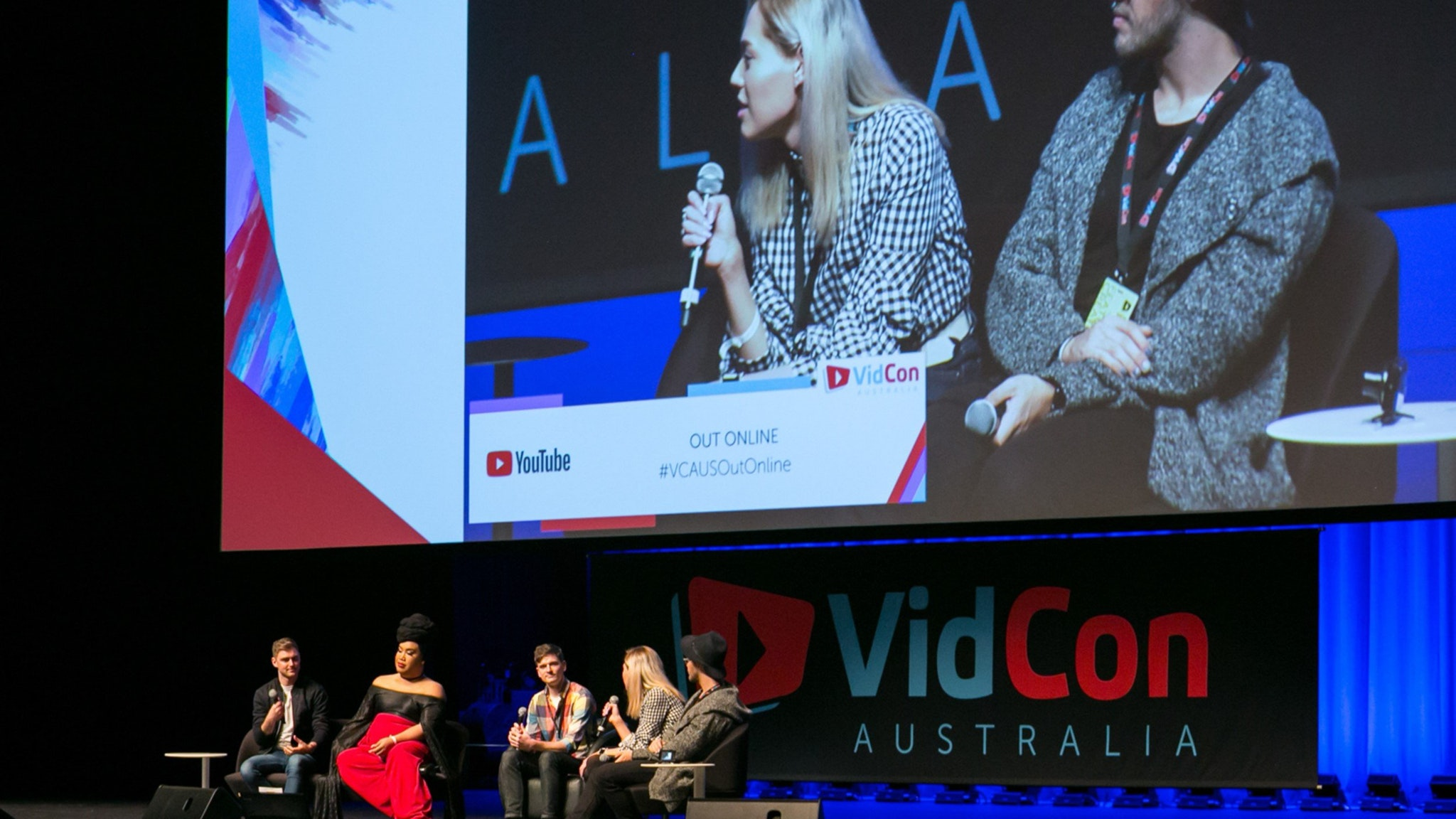 Panel of content creators on stage at Vidcon