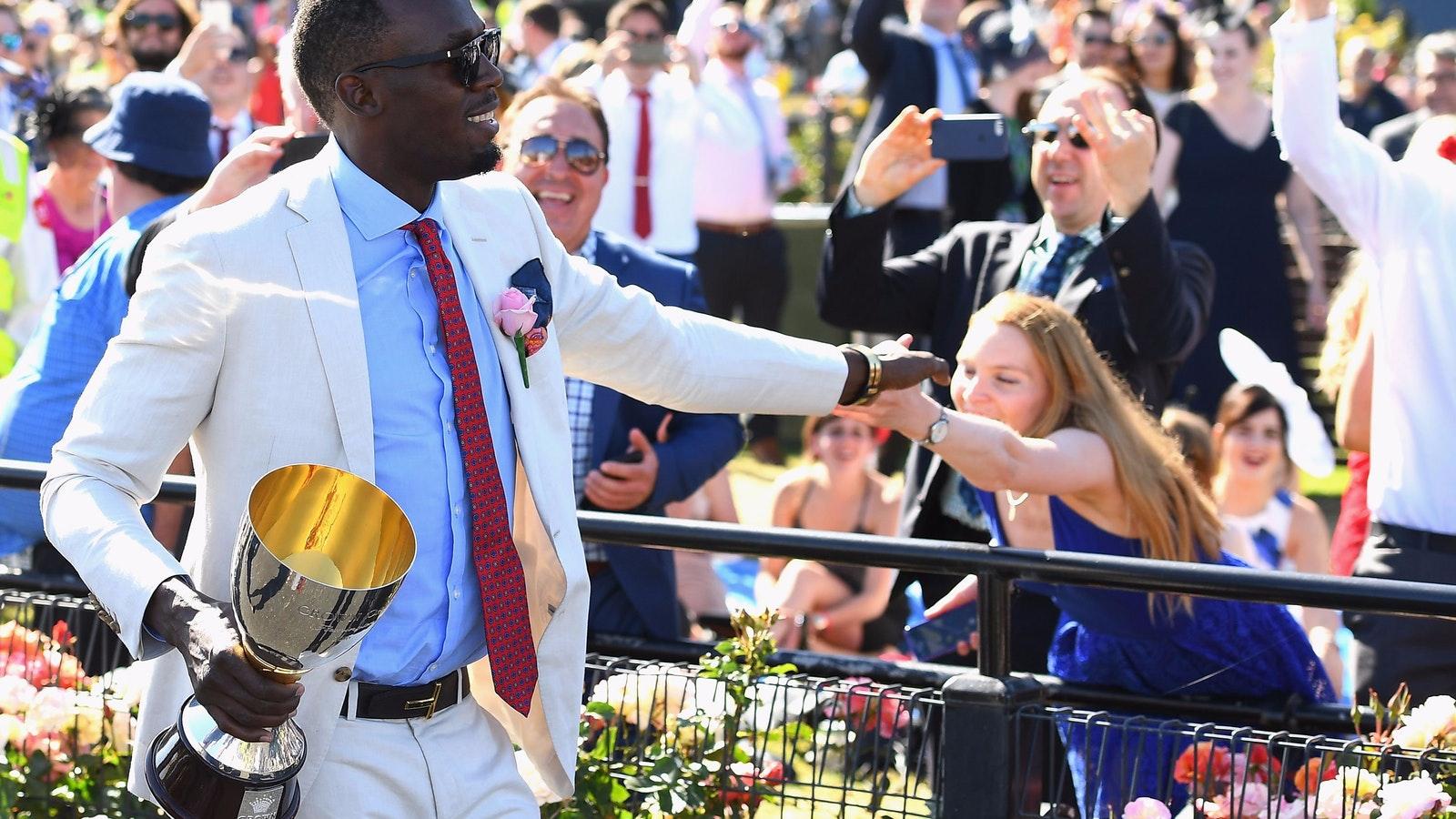 Usain Bolt presents the Oaks trophy