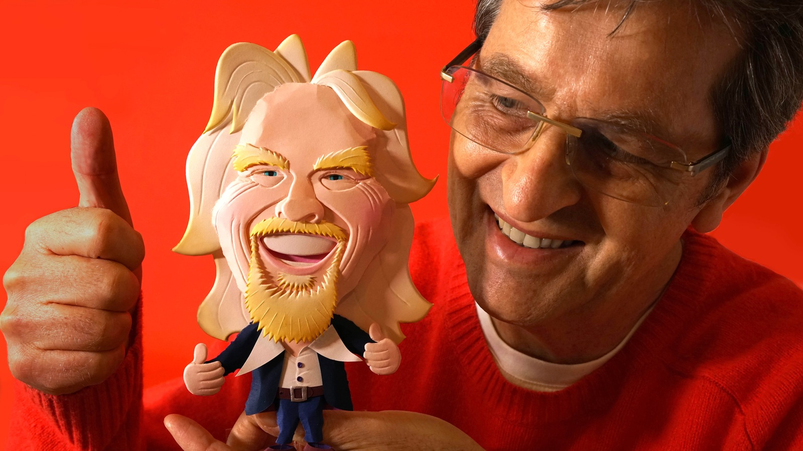 """The artist, Ray Besserdin with the Paperartzi caricature of Richard Branson called """"Thumbs Up!"""