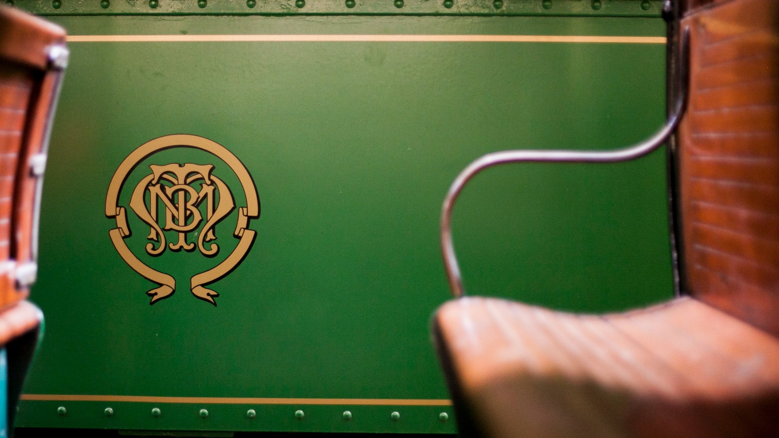Side view of tramcar, featuring distinctive monogram crest of the Melbourne and Metropolitan Tramway