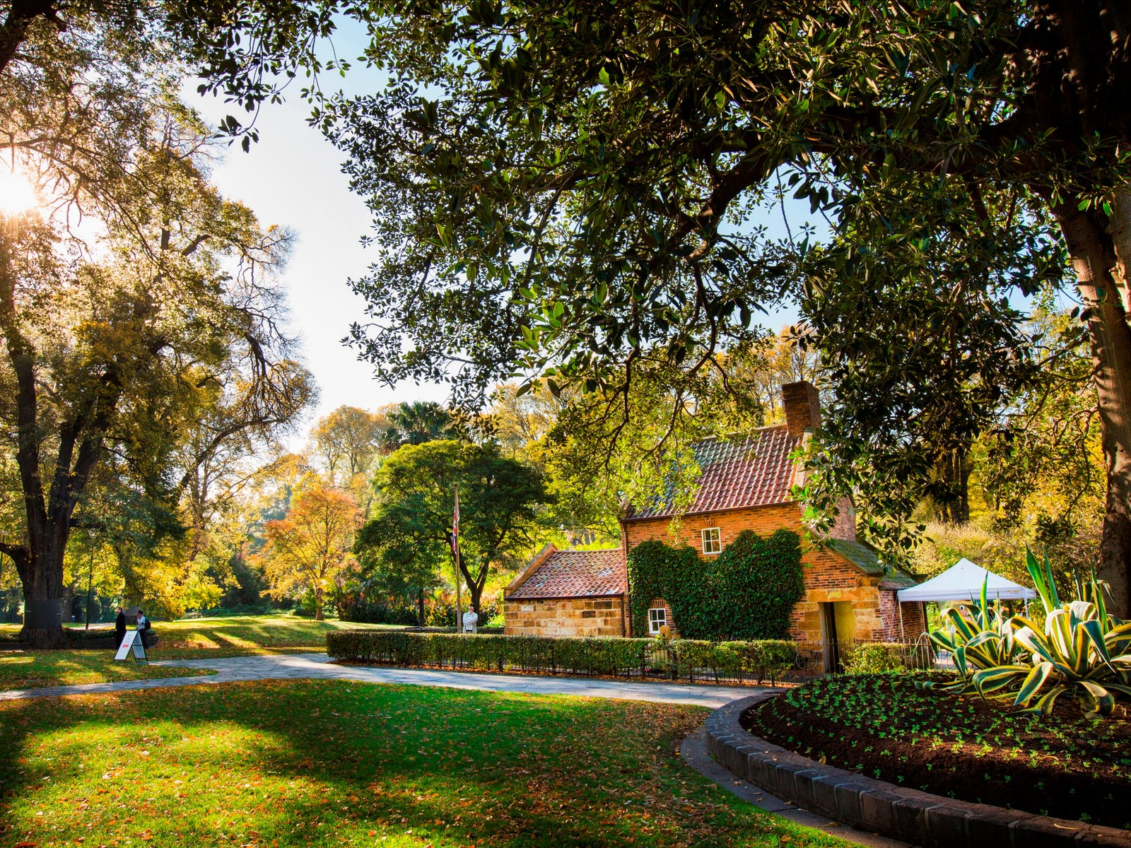 Scenic Cooks' Cottage set amongst the Fitzroy Gardens on a sunny morning