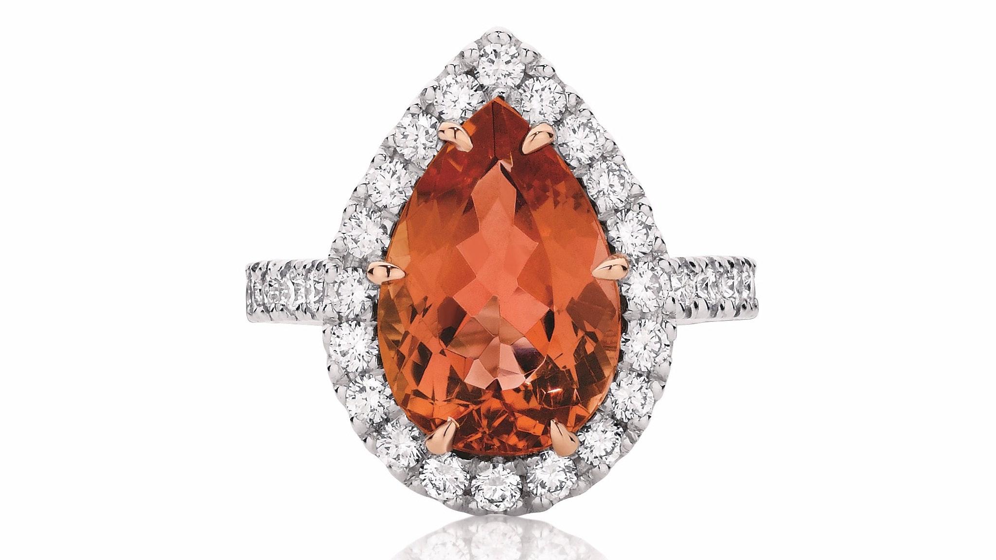 Pear cut halo dress ring