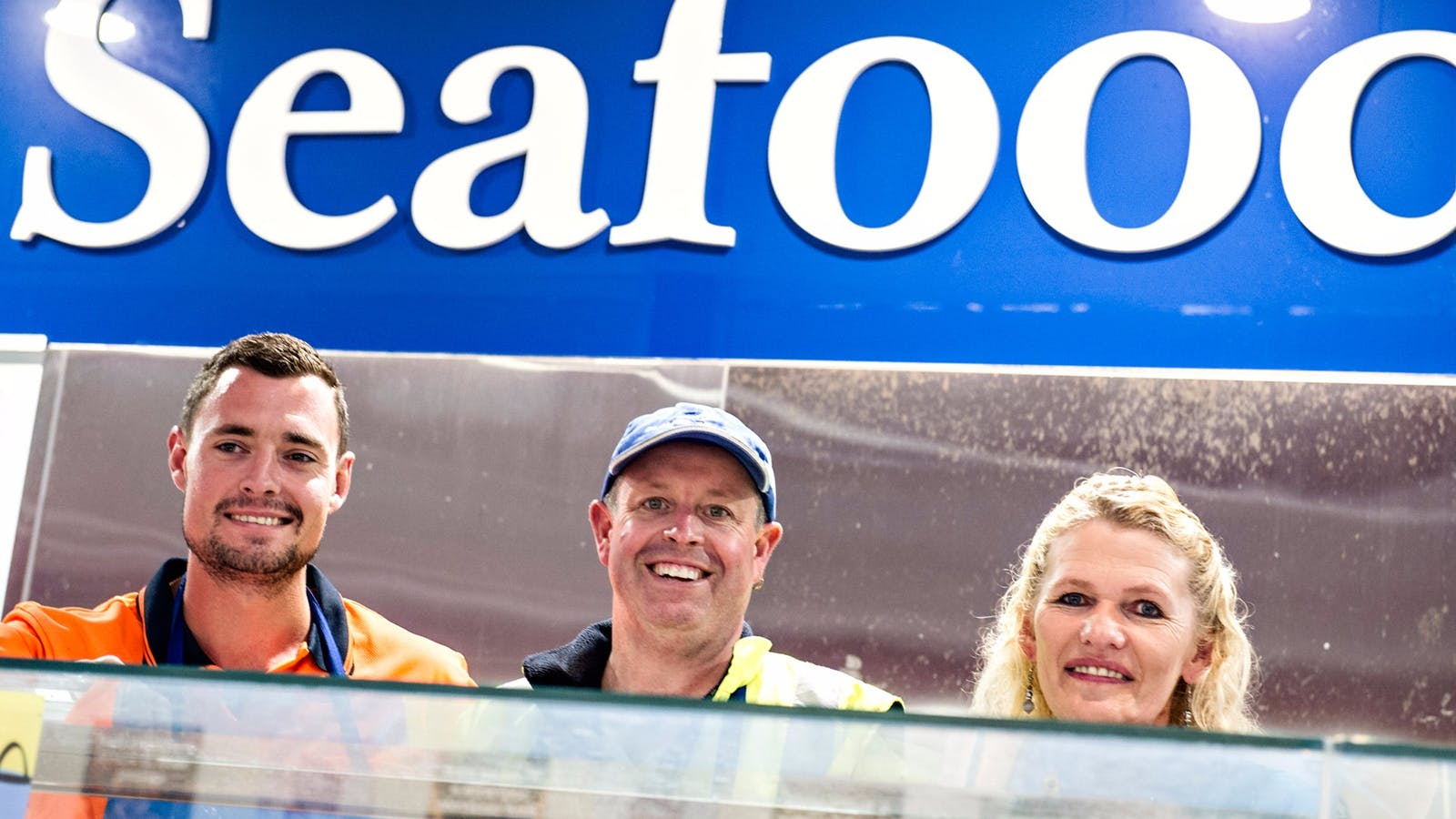 Three staff from Schwarze Seafood smile at teh camera