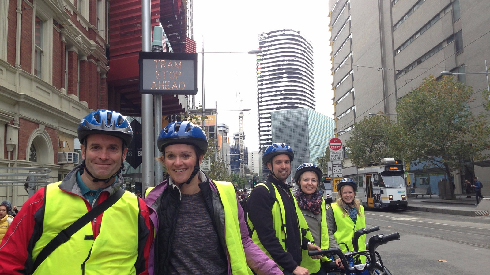 riders in front of building with a face