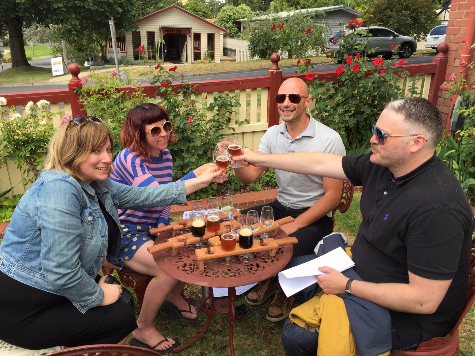 Group 'cheers' with tasting paddles of beer and gin at Loch Brewery & Distillery